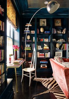 the navy lacquered walls with the velvet peach sofa, golden drapes, white pointy chair, zebra rug, over-sized silver floor lamp?  totally elegant and bohemian