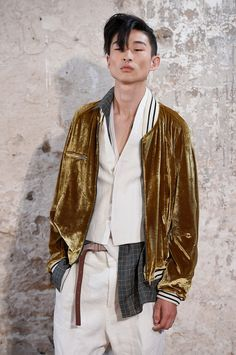 This plush Haider Ackermann bomber jacket drips off this edgy model, combining rock 'n' roll and ultimate luxe leisure