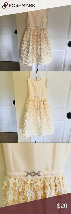 Girls Yellow rhinestone belt Easter dress new 12 Adorable Easter dress size 12 - new without tags. 100% polyester. Fully lined with crinoline at bottom. Self tie in the back. Pit to pit measurement is approx 14in. Shoulder to hem approx. 33in. Happy to answer any questions from serious buyers. Please only, fair, reasonable offers. Bundle two or more items and save 15%. American Princess Dresses Formal