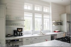 Dream House tour: 39 Blue Stem in Watercolor, florida.  I would love to have that window above our sink!