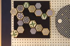 For this beautiful honeycomb-inspired artwork, we gave hexagon-shaped paper-maché a coat of gold paint and then added pretty paper. Then we glued them to a painted canvas in a bee-worthy design.