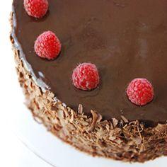 This ultra-dense milk chocolate cake has semi-sweet ganache, raspberry buttercream and  raspberry jelly slathered between each layer.