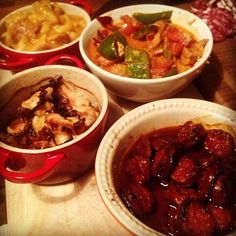 part of todays tapas feast ... chorizo with honey, garlic chicken in white wine, sherry chicken with peppers, white beans, manchega topped grilled peppers and canarian potatoes with sour cream dip