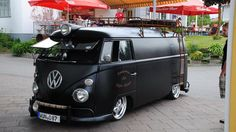 Split screen, satin black VW microbus looks sinister