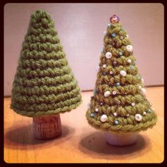 Free Pattern! CROCHET WINE/CHAMPAGNE CORK CHRISTMAS TREE  Worsted weight yarn 3.5 mm crochet hook 1.  3sc in magic ring (google this!) 2. 2sc in each sc (6) 3. Sc 6 4. (sc 1, 2sc in next sc) 3 times (9sc) 5. Sc 9 6. (Sc 2, 2sc in next sc) 3 times (12sc) 7. Sc 12 8. (Sc 3, 2sc in next sc) rep 3 times (15 sc)  9. Sc 15 10. (sc 1, 2sc in next sc) rep 7 times, 1 sc (22) 11. Sc 22  (STOP HERE FOR WINE CORK. CONTINUE FOR CHAMPAGNE CORK) 12. (Sc 10,  2 sc in next sc) rep 2 times (24 sc) 13. Sc 24