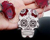 Just ordered this <3 - Sugar Skull Necklace Day Of The Dead Dia De Los Muertos Tattoo Red Rose Black and White. $26.00, via Etsy.