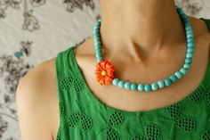 Tangerine  turquoise floral necklace, Vintage bright orange yellow dahlia Brooch Necklace - OOAK spring garden jewelry. $88.50, via Etsy.