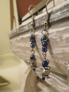 A personal favorite from my Etsy shop https://www.etsy.com/listing/268403060/dangle-earrings-with-iridescent