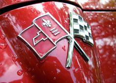 Crossed flags… C2 Corvette nose emblem / Jim & Chester's Garage