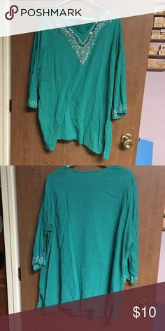 Teal v-neck tunic Teal v-neck tunic with beading around neckline and around the bottom of the arm. 3/4 sleeve Denim 24/7 Tops Tunics