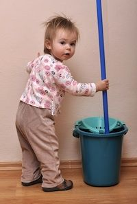 You child will naturally want to help you do things around the house.  At times, this insistence can be seen as a nuisance because it is generally easier and quicker to do the job by yourself than to have little, clumsy hands help.