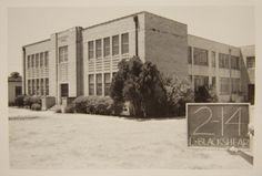 Photograph of an oblique view of the front facade of Blackshear Elementary School, located at 1712 East 11th Street, which was constructed in 1936. A two story brick building with a flat roof, the school was named for Edward Lavernia Blackshear, a former administrative supervisor of Austin's African-American schools. medium image