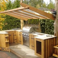 A typical outdoor kitchen would include a grill or cooking element, some counter and storage space, and possibly a sink or bar and beverage service area.