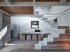 Larch interior with retro Bompani refrigerator and freezer in Italian home.