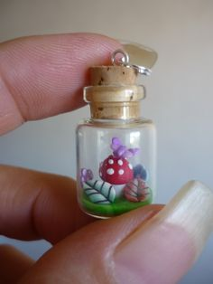 Polymer clay mushroon with butterfly on top, in tiny (16mm) glass bottle I could totally make this! All I would need to get is a glass jar...