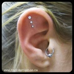 Triple Outer Conch Piercing - I like this angle. Also like the large to small look.