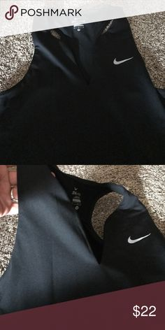 b1d0a4520131f NWOT Nike dri fit tank top Never worn. Has a slit down the middle and makes  it kind of sexy ) perfect for a good workout! I love it