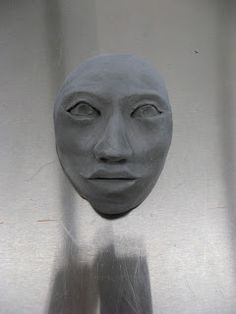 Face for garden, greenware, to be fired