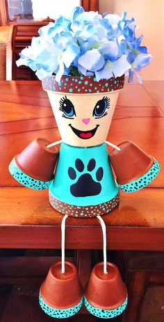 Girl or Boy Brown Turquoise Paw Print Candy Flower Dots Clay Pot Head People Terra Cotta Flower Pot Art, Clay Flower Pots, Flower Pot Crafts, Flower Planters, Clay Pot Projects, Clay Pot Crafts, Diy Clay, Flower Pot People, Clay Pot People