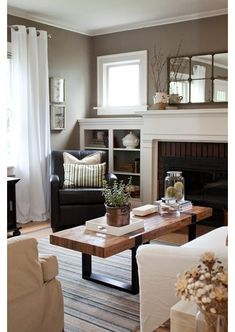 This is a really serene space.  The built in around the fireplace adds storage and decorative space.  The furniture is eclectic and interesting.  Really shows how uninteresting matchy-matchy can be.  This is inspiration to step outside of your matching box!