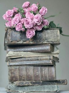 old books and fresh flowers