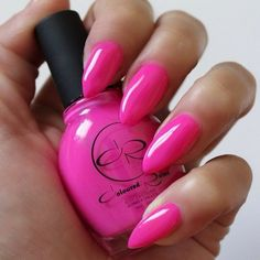 Love the intensity of the Pink nail polish, but will certainly pass on the shape of her nails