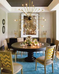 The ceiling painted in black together with the multi tier golden chandelier gives an ilusion of an incredible starry night sky. The stylish ...