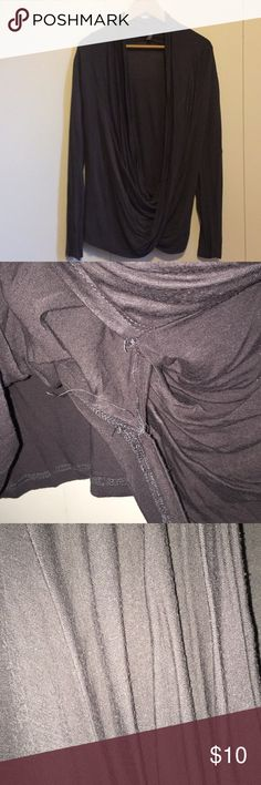 Grey wrap front top Cute and comfy free wrap top. In GUC, some pilling that i tries to show in a pic, also some loose string that can't be seen as it's under the wrap part. Adorable and lightweight perfect for layering. Tops Tees - Long Sleeve