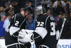 LOS ANGELES, CA - MARCH 16: Goalie Jonathan Quick #32 of the Los Angeles Kings celebrates with Matt Greene #2 after his shutout against the Arizona Coyotes at Staples Center on March 16, 2015 in Los Angeles, California. The Kings won 1-0. (Photo by Stephen Dunn/Getty Images)