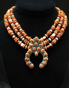 Orange spiny oyster shell and sterling silver Native American finished squash blossom necklace