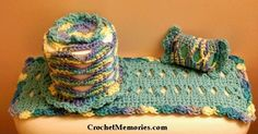 """Work up a pretty bath set using a fun stitch. Continue with an edging worked with """"shell baskets"""" another fun stitch! You'll enjoy ..."""