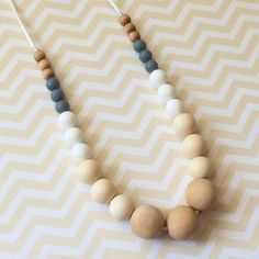 The Malibu~Sands teething necklace is now back in stock!  The neutral color way of cream, white and grey goes with so many fall fashions!  Our necklaces are handcrafted with high quality materials that are safe for babies to chew on while mom stays stylish: ➕silicone beads which are FDA approved, food grade and free of nasty chemicals ➕natural maple wood beads hand finished by me with organic coconut oil to preserve the wood ➕satin cord and breakaway safety clasps  They're also a perfect…