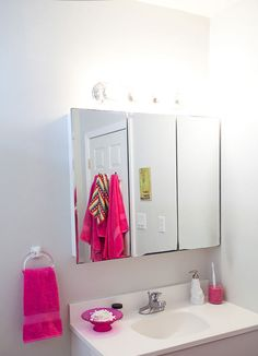 i like the simple hot pink accents in this bathroom...sneak peek: sarah shreves