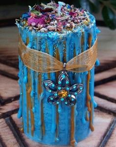 FAERIE FIRE Ritual Soy Spell Pillar Candle is magically charged with a pentalpha of Fae favored herbs and flowers including Elfin Thyme, Clover, Foxglove flowers, Heather flowers, and Rose petals. Sparkling with sky blue and amber crystal rhinestones hung on amber gold sheer organdy ribbon.  Use this candle for Imbolc or Ostara sabbat celebrations, Celtic faery magic, and ritual spellwork involving visions, second sight otherworld pathworking, divination, shadow work.