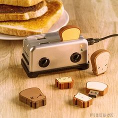 4 port USB hub that looks like a tiny little toaster. Of course, it has USB drives that look like bread. A) Adorable B) So much easier to use than trying to plug USB sticks into the stack under my desk
