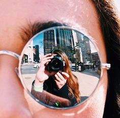 i chose this photo because it uses a simple photo of a glasses lens and makes whats in the reflection the focus.