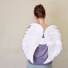 Updated my last-minute paper plate angel wings yesterday. Find the original how-to here: http://bit.ly/1voYFPL #halloween #diycostume
