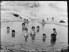 Maori children in a hot thermal pool at Whakarewarewa, ca 1910 by William Henry Thomas Partington.