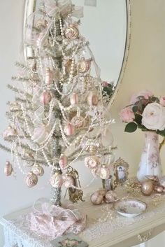 pearls and pink vintage ornamens on small tree