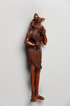 Ashinaga (Long Legs) and a Daoist Sage Period: Edo period (1615–1868) Date: 18th century Culture: Japan Medium: Wood Classification: Netsuke