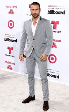 OK, we need a moment: The Mexican actor is one tall drink of water in a slim-fitting gray suit, which he pairs with mahogany shoes.