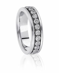 Bezels Of Precicious Metal Are Burnished With Round Brilliant Diamonds In The Channel Of This Contemporary Eternity Wedding Ring For Both Men & Women