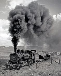 K-37 steams along somewhere between Chama, New Mexico and Durango, Colorado. The K-37 class was the last of the D&RGW narrow gauge 2-8-2 Mikados, and were actually just standard gauge 2-8-0's that had been converted. There were 10 made, #490-499.