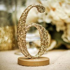 Wedding table numbers for unique wedding table decor. Choose your color, font, and base style for truly unique wedding table numbers. Whether you are looking for a vintage and rustic feel or are searc
