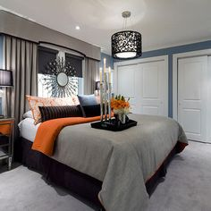 Blue/Gray/Orange bedroom minus the wall burst and replace lighting with recessed.