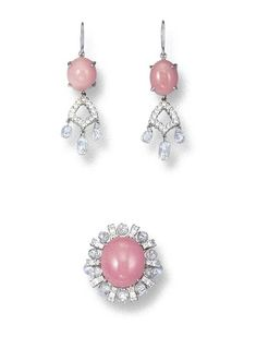 A SET OF CONCH PEARL AND DIAMOND JEWELLERY  Comprising a ring, set with a conch pearl measuring approximately 12.40 x 11.00 x 9.55, to the faceted diamond bead surround with diamond-set bar spacers; and a pair of ear pendants, each set with a conch pearl suspending a diamond-set frame and diamond briolettes, mounted in 18k white gold.