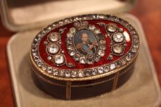 The Bismarck Box, Fabergé, 1884. The jeweled objet features a miniature portrait of Tsar Alexander III amidst diamonds and red sunburst enamel. It was presented by the Tsar to Prince von Bismarck in 1884. Photo courtesy Patrick Mark/Arts Alliance