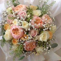 Beautiful bridal bouquet of Romantic Vuvuzela, Avalanche, Peach Avalanche, gyp and Thlaspi