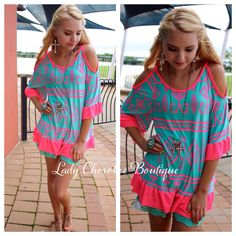 """https://instagram.com/ladycherokeeboutique Neon Desert  NEON PINK & TURQUOISE TRIBAL PRINT OPEN SHOULDER TUNIC ✨Chandler is wearing a Small✨ Price: $35.00, Free Shipping Qty: 2 small, 2 medium, 2 large  Please comment """"Sold"""", State, Size, and quantity needed, as well as your email to purchase. Also, you must let us know what state you live in, before we can invoice you!"""