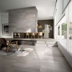 Transform your interior and turn into modern space by making one small change - tiles everywhere. Beautiful tile collection Re-Work, Multi Fog Grey - on the floor, wall, stairs and fireplace, extending outside on terrace. Living Comedor, Concrete Tiles, Concrete Floor, Wall And Floor Tiles, Home And Living, Sweet Home, New Homes, House Ideas, House Design